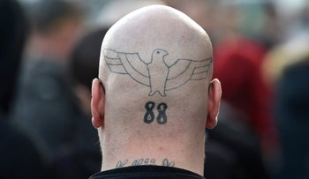 """FILE PHOTO: A neo-Nazi with the """"88"""" code on the back of his head demonstrating during the anniversary of Hitler's birthday in April 2016."""