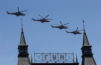 Russian Mi-35 military helicopters fly during the Victory Day parade, marking the 71st anniversary of the victory over Nazi Germany in World War Two, above the Red Square in Moscow, May 9, 2016.