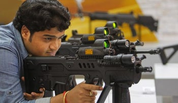 Israeli guns at a security expo in India, 2014.