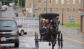 an Amish family pictured in August 2014 in Heuvelton, New York.