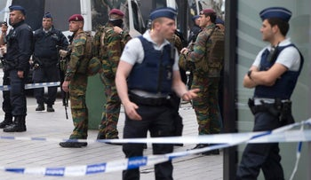 Belgian police and Belgian Army soldiers stand guard at the scene of a bomb alert on a major shopping street in Brussels, Belgium, June 21, 2016.