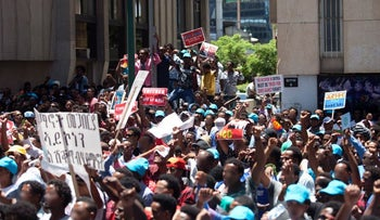 Eritrean asylum seekers protest against their government at the EU's office in Ramat Gan on June 21, 2016.