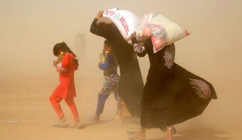 Displaced Iraqis among 60,000 fleeing the war against the Islamic State in the past month, leave Fallujah with limited relief supplies on June 20, 2016.