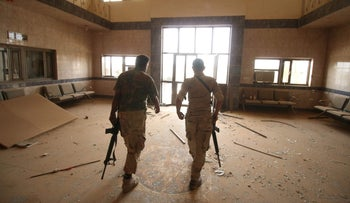 Iraqi pro-government forces check a building in the Officers neighborhood of Fallujah as they try to clear the city of ISIS fighters still holed up in the former jihadi bastion on June 19, 2016.