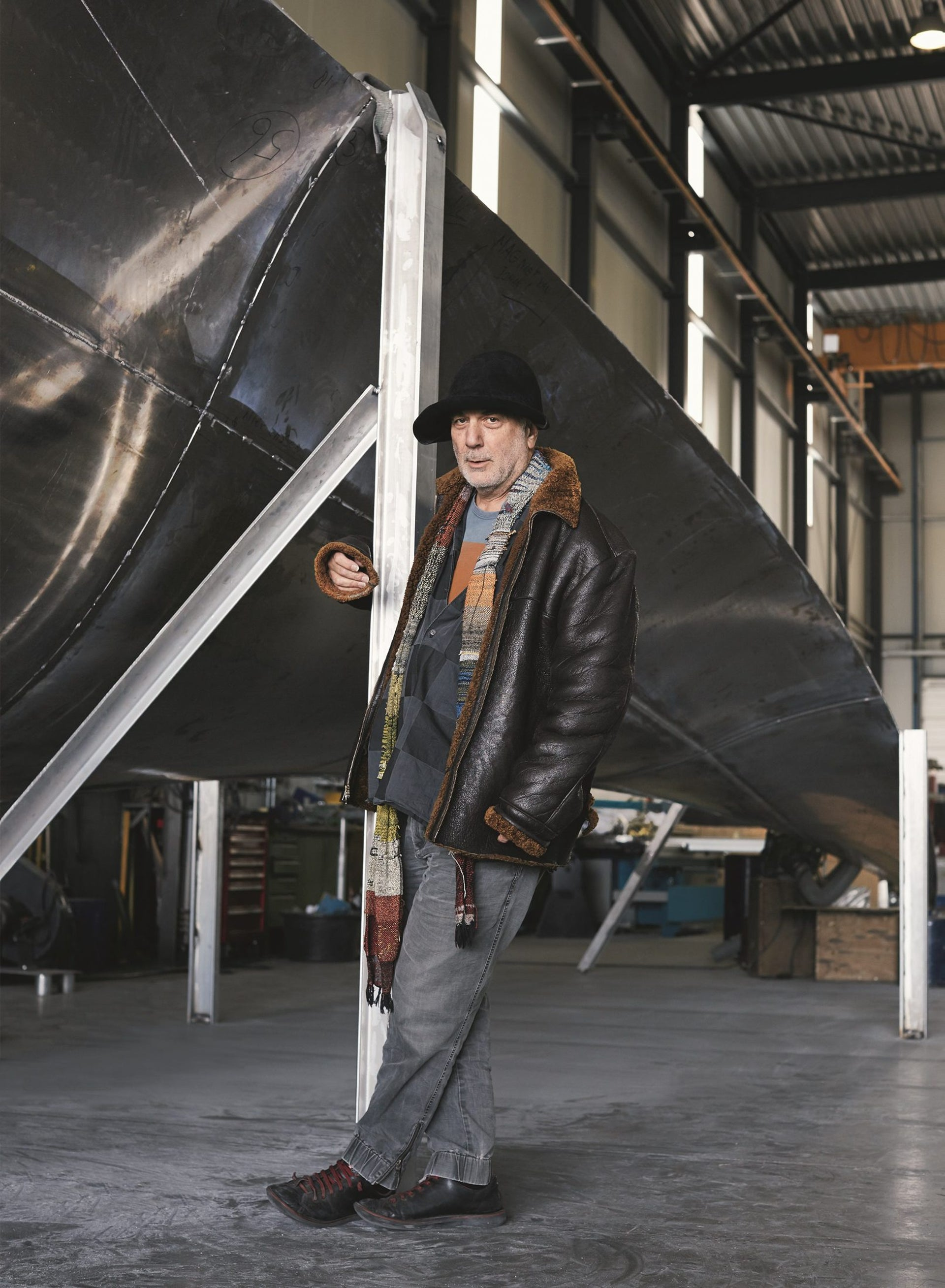 """Ron Arad with his sculpture, """"Thought of Train of Thought,"""" which will be exhibited at St. Pancras International train station in London this summer."""
