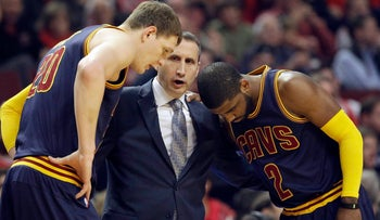 Former Cavaliers coach David Blatt, center, talks with two players during a playoff series game in Chicago May 14, 2015.