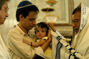A Jewish naming ceremony at the Magen Hassidin Synagogue in Mumbai, India, Thursday, September 13, 2007.