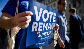 """Campaigners from the """"Vote Remain"""" group hand out stickers, flyers and posters in Oxford Circus, central London on 21 June 2016."""