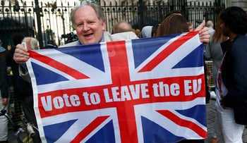 """A """"leave"""" supporter holds a Union flag following the result of the EU referendum, outside Downing Street in London, June 24, 2016."""