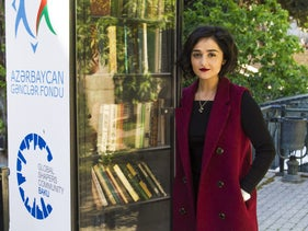 Public Bookcase curator Zeynab Jahan standing next to Baku's latest, unlikely tourist attraction.