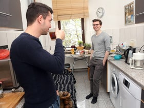 Roommates Constantin Thieme (right) and Syrian refugee Hamad, who were introduced by the German organization Refugees Welcome.