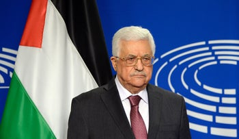 Palestinian President Mahmoud Abbas poses for photographs at the European Parliament in Brussels, June 23, 2016.