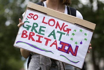 """A demonstrator holds a placard that reads """"So Long Great Britain"""" during a protest against the pro-Brexit outcome of the UK's referendum on the European Union (EU), in central London on June 25, 2016."""