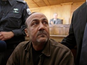 Jailed Fatah leader Marwan Barghouti attends a deliberation at Jerusalem Magistrate's court, in this January 25, 2012 file photo.