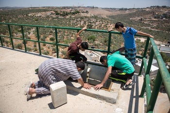 Locals looking for water in the West Bank village of Qarawat Bani Hassan, June 20, 2016.