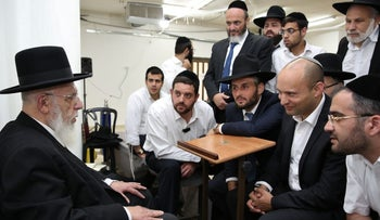 Naftali Bennett paying a condolence call to Rabbi Shalom Cohen, June 23, 2016.