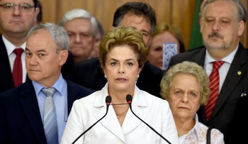 Brazil's suspended President Dilma Rousseff makes a statement next to her mother Dilma Jane Coimbra(R) at the Planalto Palace in Brasilia on May 12, 2016.