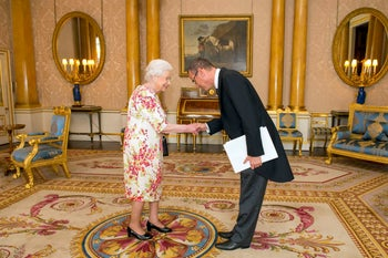 Israel's new ambassador to England, Mark Regev, meeting Queen Elizabeth during a private audience at Buckingham Palace, London, June 24, 2016.
