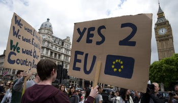 A demonstrator holds a placard during a protest against the outcome of the U.K.'s June 23 referendum on exiting the European Union, London, U.K., June 25, 2016.
