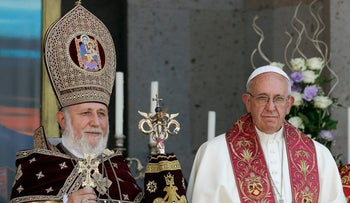 Pope Francis, right, participates in the Divine Liturgy celebrated by Catholicos Karekin II, left, at the Armenian Apostolic Cathedral in Etchmiadzin, Yerevan, Armenia, June 26, 2016.