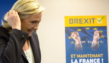 "French far-right leader Marine Le Pen arrives for a press conference at the National Front party headquarters outside Paris, June 24, 2016. The poster reads ""Brexit. And now, France."""