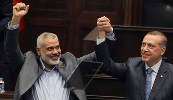 In this Tuesday, Jan. 3, 2012 file photo, Gaza's Hamas Prime Minister Ismail Haniyeh, left, and then Turkish Prime Minister Recep Tayyip Erdogan, together at the Parliament in Ankara, Turkey.