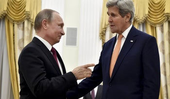 Russian President Vladimir Putin (L) speaks with U.S. Secretary of State John Kerry during a meeting in Moscow, Russia on March 24, 2016.