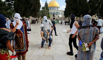 Masked Palestinians gather during clashes with Israeli police during the holy month of Ramadan near The Dome of the Rock (seen in background) on the compound known to Muslims as Noble Sanctuary and to Jews as Temple Mount in Jerusalem's Old City June 28, 2016. An Israeli police spokesman said on Tuesday that the compound would be closed to visitors, including Jewish visitors, for three days in response to clashes, in which masked Palestinians threw stones at Israeli policemen and some 16 suspects were detained by the police.