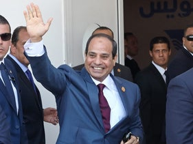 Abdel-Fattah el-Sissi, Egypt's president and subject of Daoud's criticism, waves in Ismailia, Egypt Aug. 6, 2015.