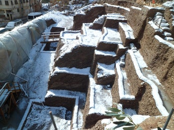 The dig of Jerusalem's Roman era landfill, roughly 2,000 years old, covered in snow: Cities of the time usually threw their garage onto the street and left it there, at best. Orderly trash disposal was unknown.