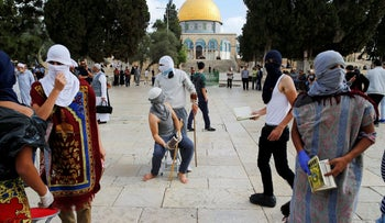 Masked Palestinians at the Temple Mount, June 28, 2016.