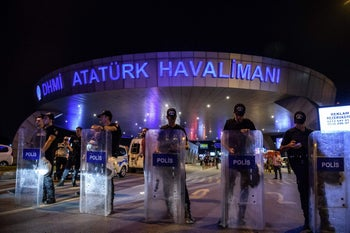 Turkish anti-riot police officers block the main entrance of the Ataturk airport in Istanbul June 28, 2016 after explosions followed by gunfire hit Turkey's biggest airport.
