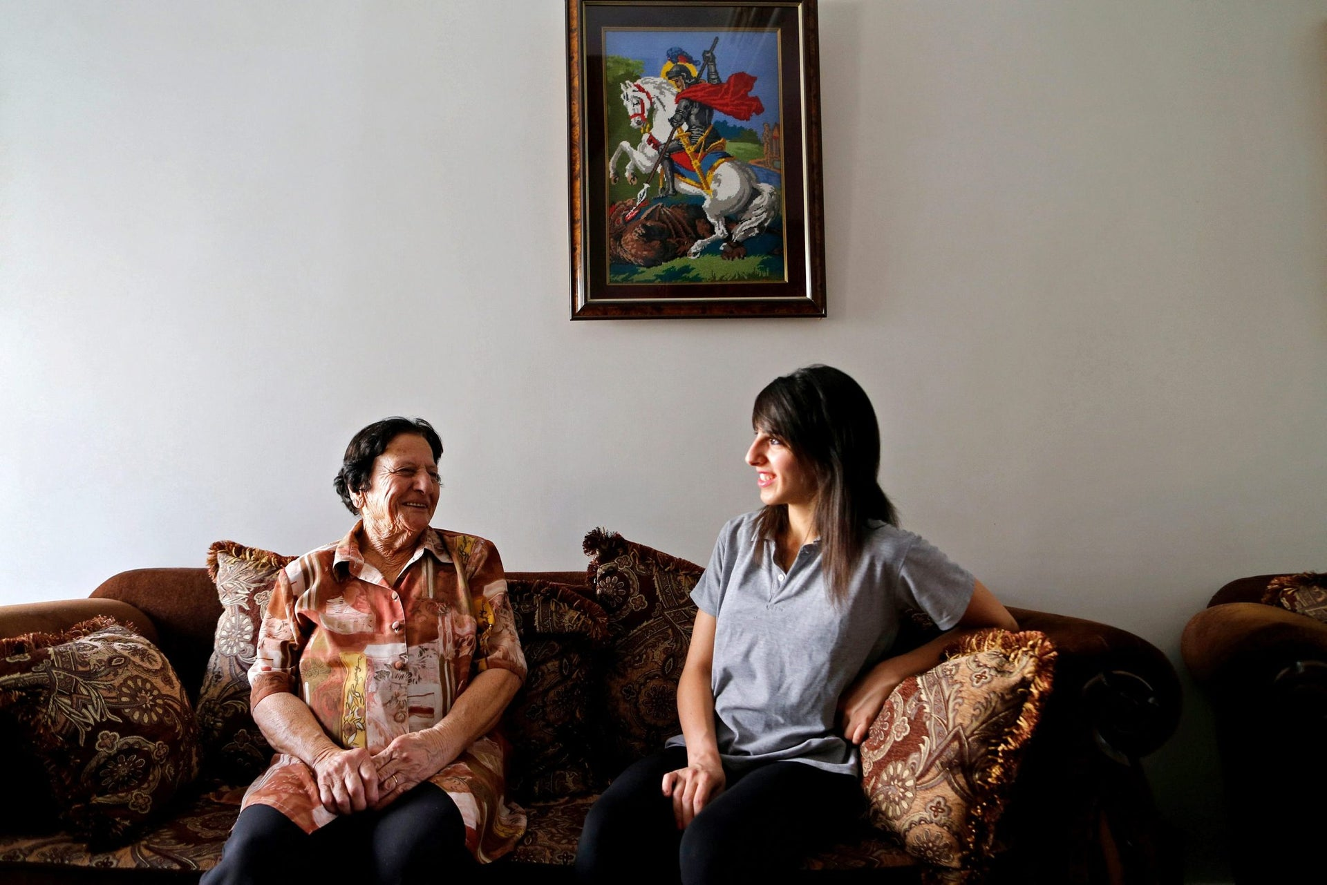 Palestinian swimmer Mary Al-Atrash (R), 22, who will represent Palestine at the 2016 Rio Olympics, sits with her grandmother in Beit Sahour, near the West Bank town of Bethlehem, June 27, 2016.