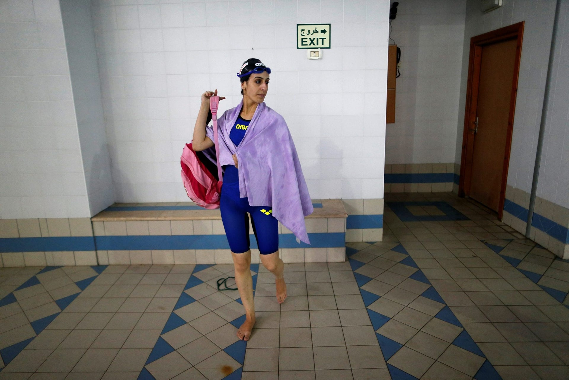 Palestinian swimmer Mary Al-Atrash, 22, who will represent Palestine at the 2016 Rio Olympics, leaves after training in a swimming pool in Beit Sahour, near the West Bank town of Bethlehem June 27, 2016.