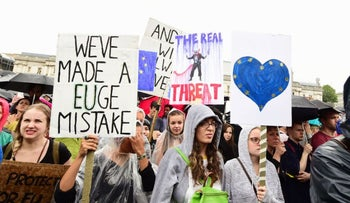 Supporters hold a banners during a pro-EU rally in Trafalgar Square in London, after some of the pro-EU events organized in the aftermath of last week's historic referendum have been cancelled at short notice over safety concerns, Tuesday, June 28, 2016.