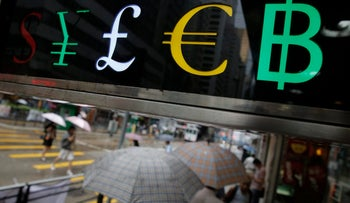 The currency signs of the English pound and the euro are displayed at a money exchange store in Hong Kong, June 28, 2016.