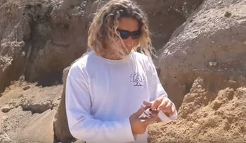 Lifeguard Meir Amsik showcases the ancient oil lamp he discovered on the Ashkelon beach.