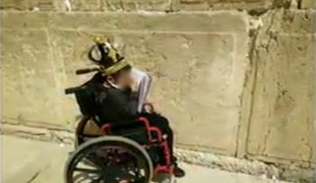 Five-year-old with cancer patient, S. at the Western Wall in Jerusalem.