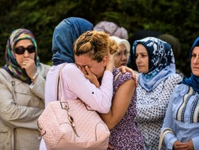 Relatives of suicide attack victim Mohammad Eymen Demirci mourn on June 29, 2016 in Istanbul during his funeral a day after a suicide bombing and gun attack targeted Istanbul's Ataturk airport.