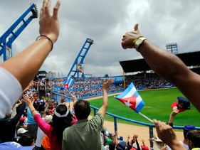 Spectators cheering during a baseball match between the Tampa Bay Rays and the Cuban national team in Havana, March 2016.