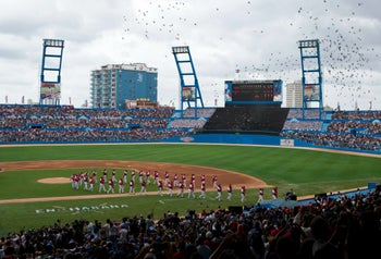 The Tampa Bay Rays and the Cuban national team enter the Latinoamericano stadium in Havana, March 2016.