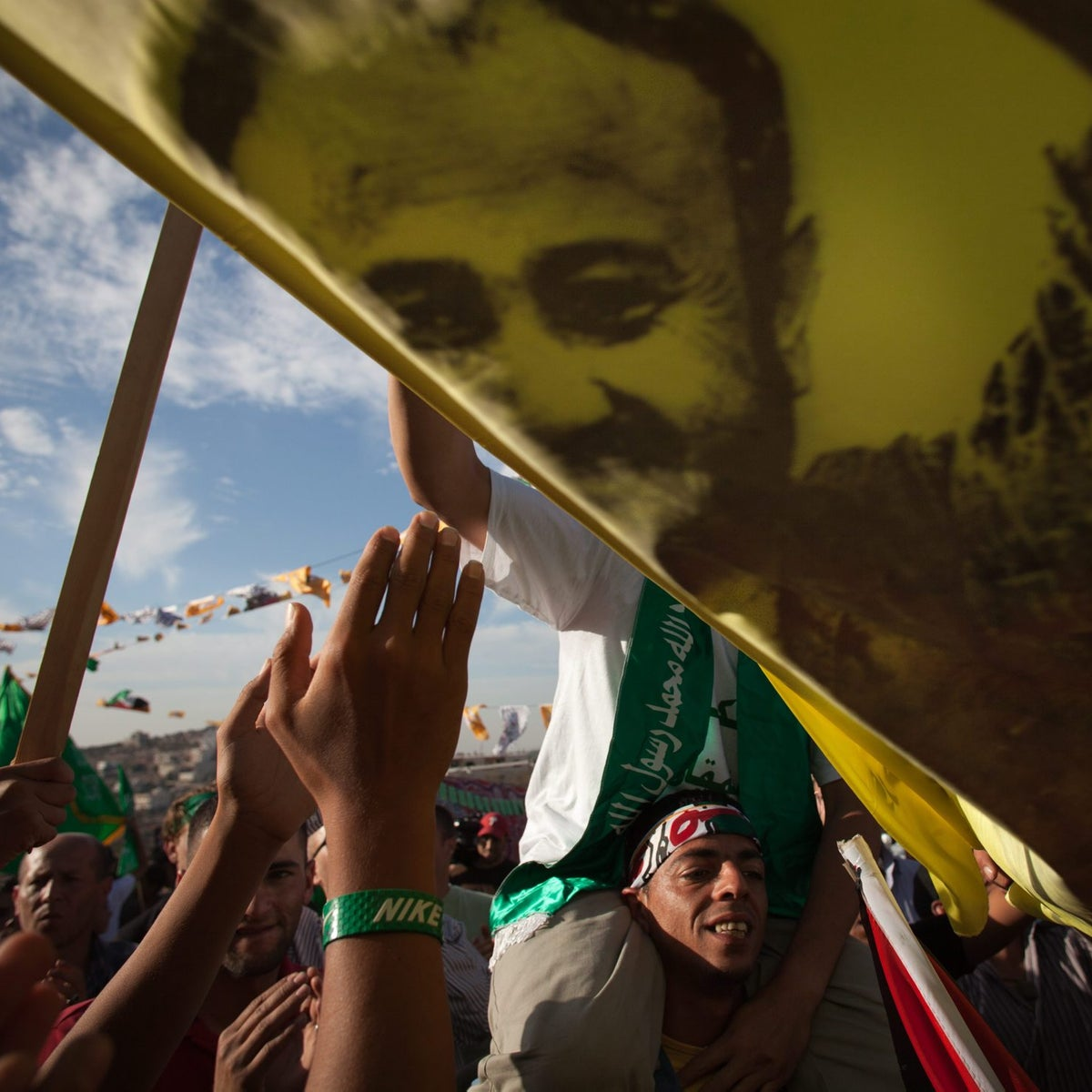 Palestinians celebrating the Shalit prisoner swap wave a flag with a picture of Marwan Barghouti in the West Bank village of Kobar, October 2011.