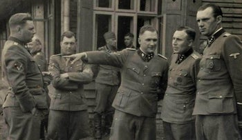 This 1944 photo provided by the U.S. Holocaust Memorial Museum (USHMM) shows a group of SS officers gathered in front of a building at Solahutte, the SS retreat outside of Auschwitz, Poland.