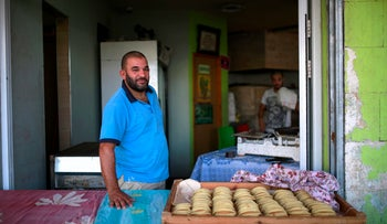A qatayef stall in Lod. Offering a chance to break the fast with something sweet.