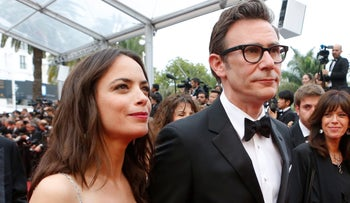 Actress Berenice Bejo for photographers with her husband upon arrival for the screening of the film The BFG at the Cannes Film Festival, France, May 14, 2016.