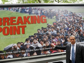 UKIP leader Nigel Farage poses during a media launch for a controversial EU referendum poster, June 16, 2016.