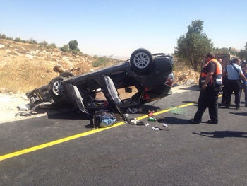 The car in which Rabbi Michael Mark and his family were riding on July 1, 2016 near Hebron when a Palestinian gunman opened fire, causing the car to crash and flip over.