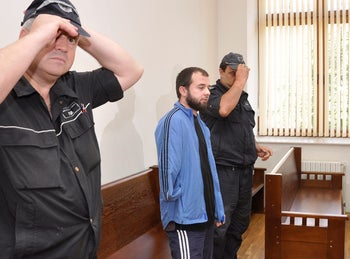 Chechen Akhmed Chatayev (C) is seen at the start of his trial in the court in Haskovo, Bulgaria, June 17, 2011.
