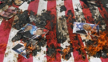 A picture of Prime Minister Benjamin Netanyahu among the torched detritus of a Quds Day rally in Tehran on Friday.
