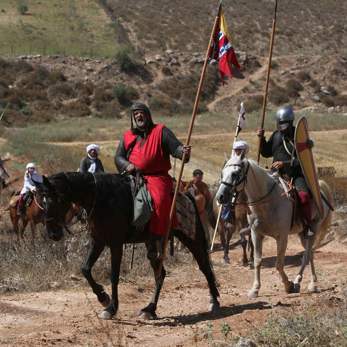 Israeli members of knight clubs, dressed in costumes ride horses on July 1, 2016 before taking part in the reenactment of the Battle of Hattin (aka the Horns of Hattin) in the ancient northern city of Tzipori to Horns of Hattin, an extinct volcano with several peaks. Israelis, mostly of Russian origin, took part in the reenactment of the battle that was fought on the same day in 1187, when Arab Sultan Salaheddin's army crashed the Crusader forces on his way to Tiberias.